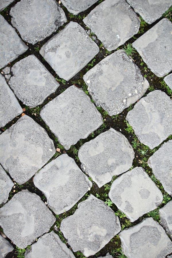 Вымощенная дорога в Риме стоковые изображения rf
