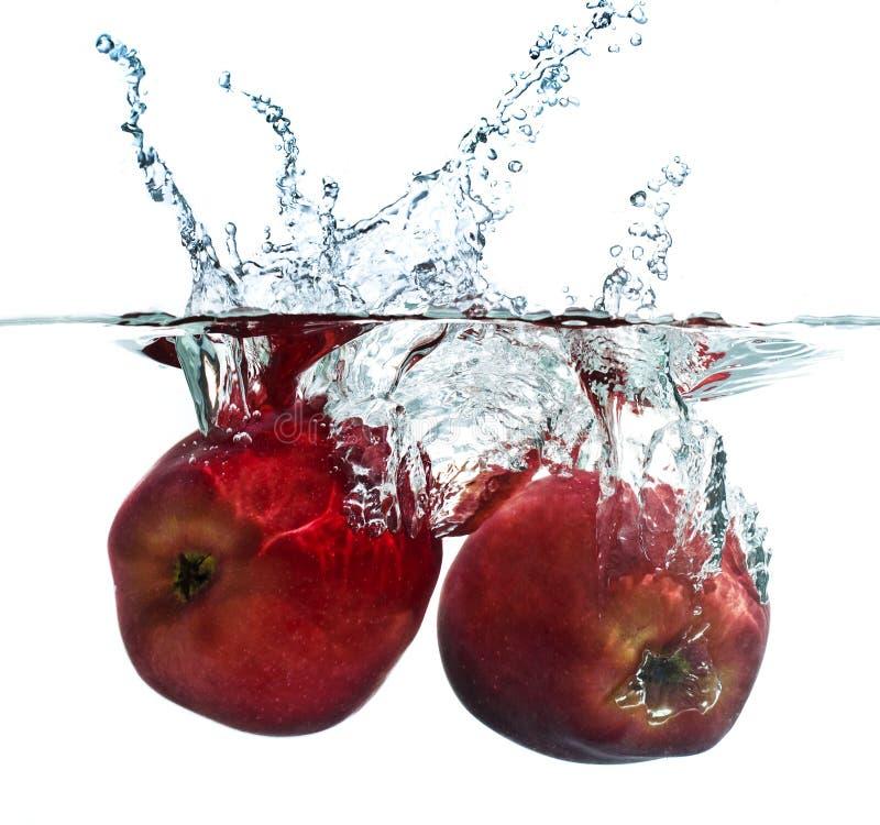 выплеск яблока стоковые изображения rf