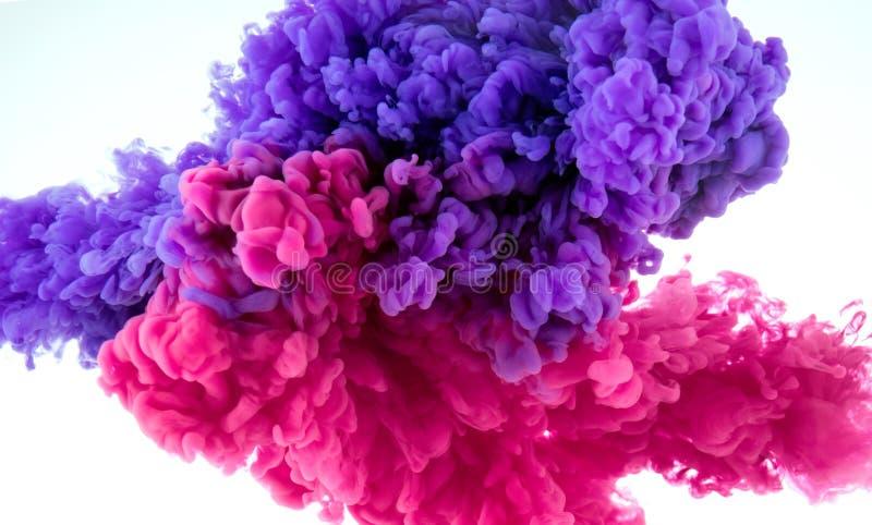 Выплеск цвета чернил в воде - смешайте предпосылку стоковые фото
