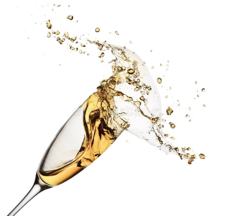 Выплеск Шампани от стекла изолированного на белой предпосылке стоковое фото rf