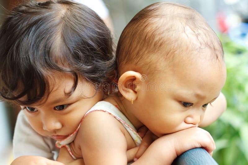 выражение азиатских детей этническое стоковое изображение