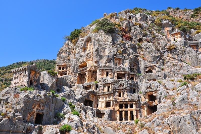 Вырезанные в скале усыпальницы в Myra, Турции стоковые изображения rf