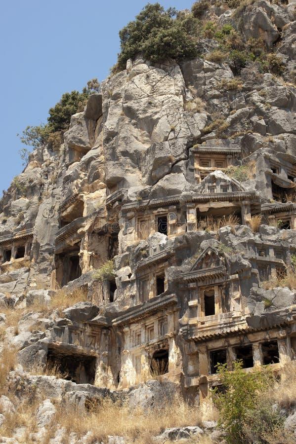Вырезанные в скале усыпальницы в Myra, Demre, Турции, сцене 1 стоковая фотография