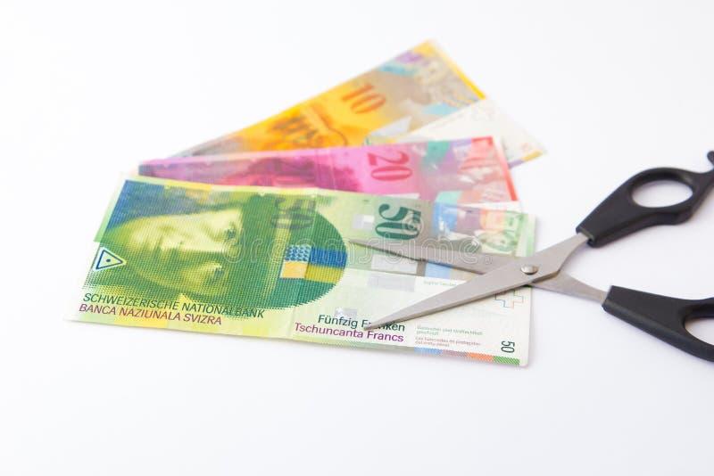 Вырезывание денег сохраняя швейцарский франк стоковое фото rf