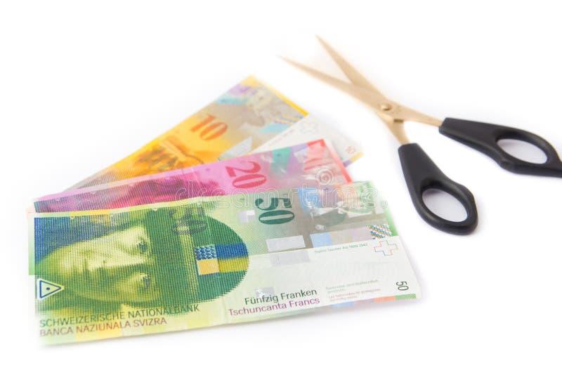 Вырезывание денег сохраняя швейцарский франк стоковое изображение