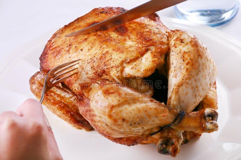 Высекать цыпленка Rotisserie стоковое фото rf