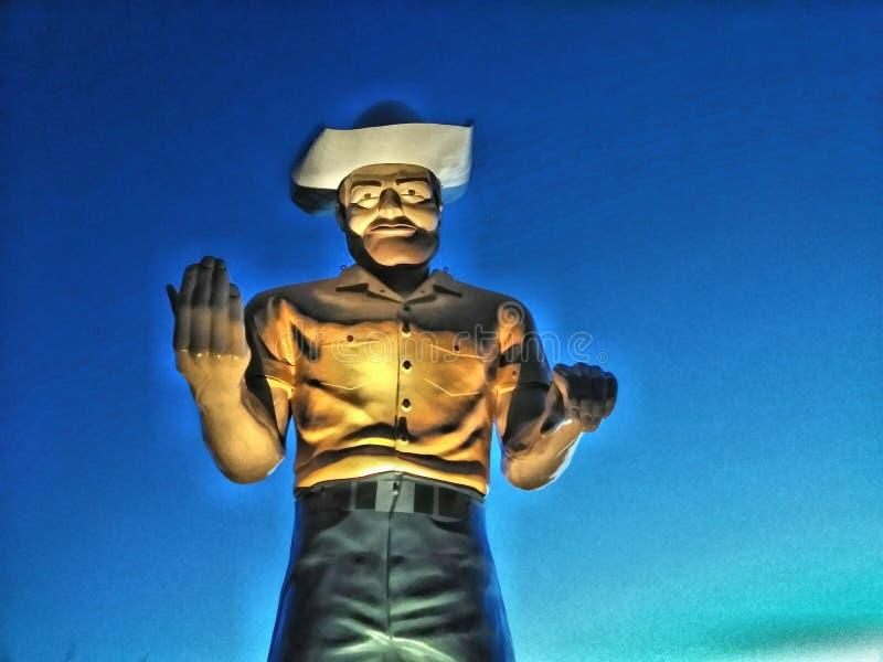 Высокорослая статуя ковбоя обочины стоковые фото