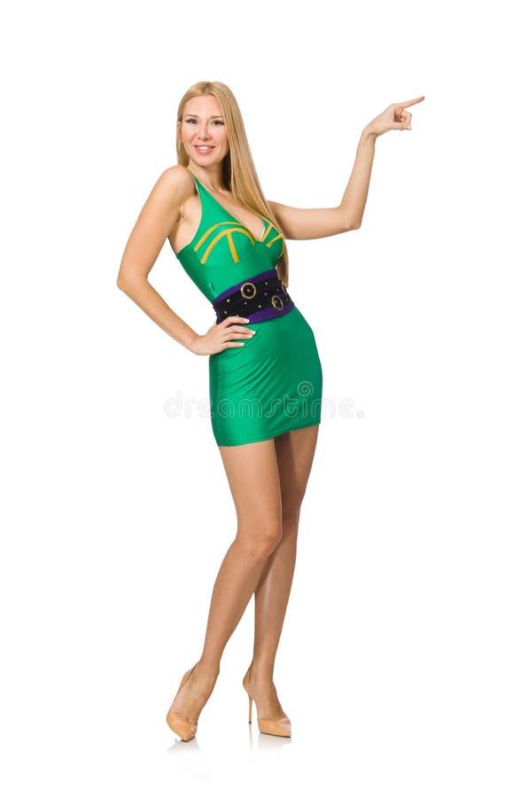Высокорослая модель в мини зеленом платье изолированном на белизне стоковые фотографии rf