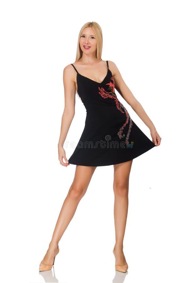Высокорослая молодая женщина в черном платье изолированном на белизне стоковая фотография rf