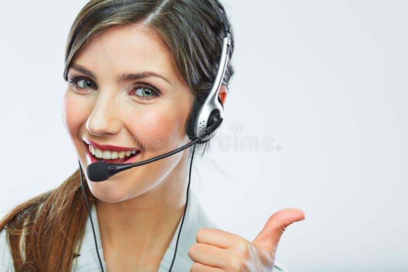 Выставка большого пальца руки оператора работы с клиентом деятельность центра телефонного обслуживания усмехаясь стоковые фотографии rf