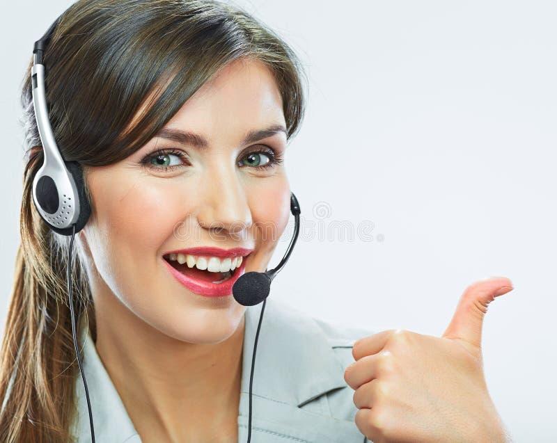 Выставка большого пальца руки оператора работы с клиентом деятельность центра телефонного обслуживания усмехаясь стоковое фото rf