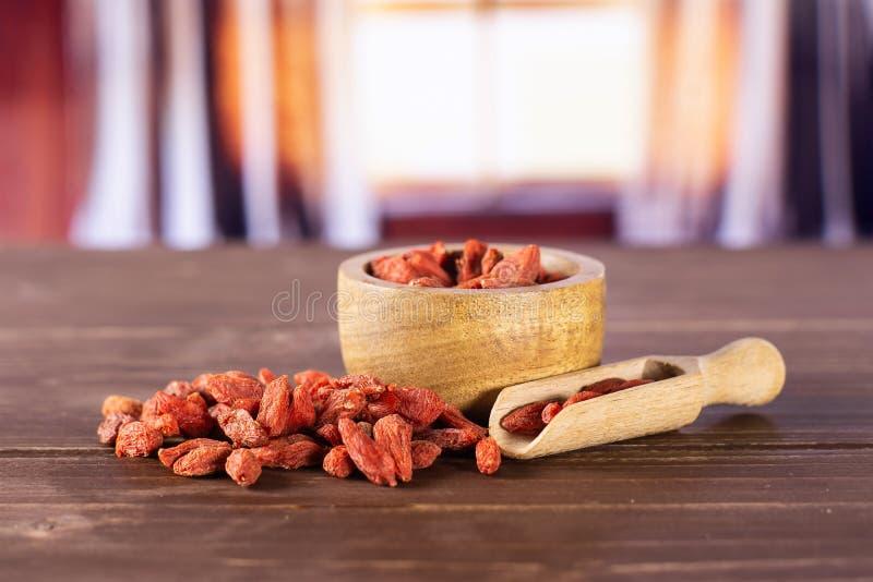 Высушенные красные ягоды goji с занавесами стоковое фото rf