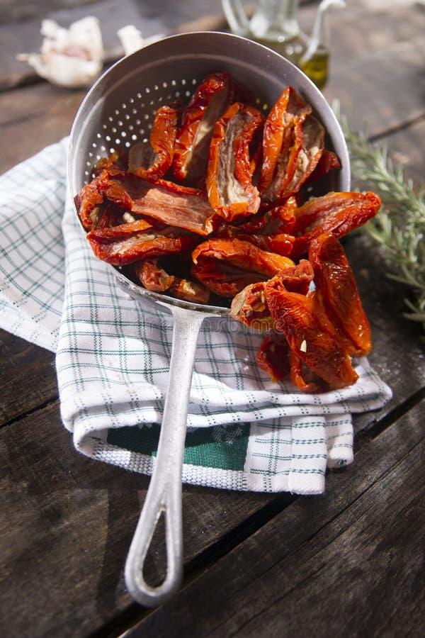 Высушенные томаты с розмариновым маслом стоковые изображения