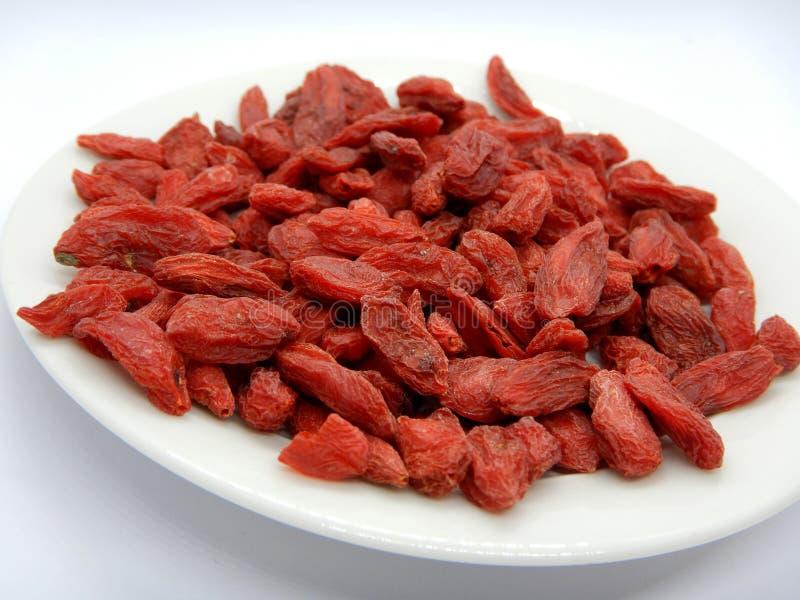Высушенные ягоды Goji изолированные на белизне стоковая фотография rf