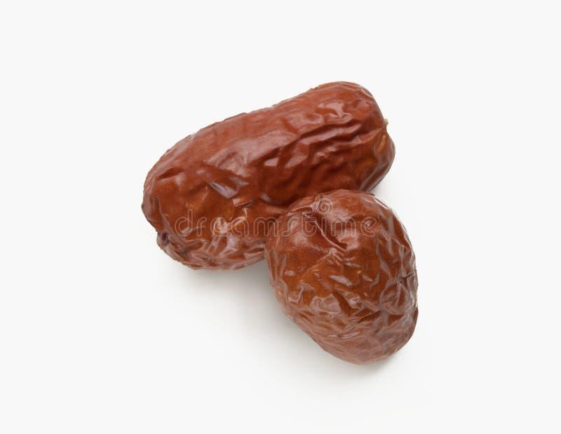Высушите сладостное яблоко Jujube или обезьяны при коричневая кожа изолированная на whi стоковые фотографии rf