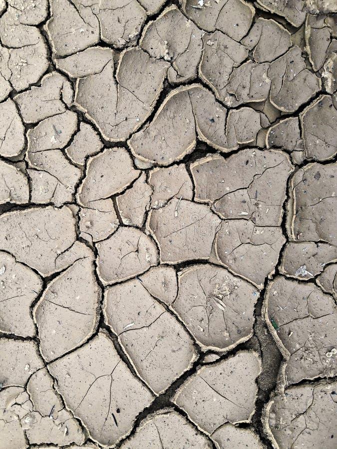 Высушите треснутую землю - засуху стоковое изображение rf