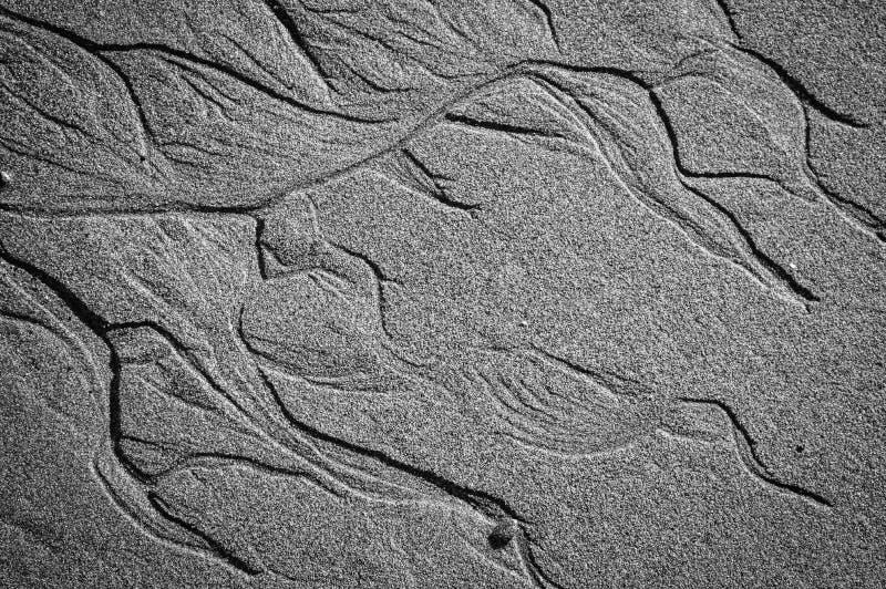 Вытравливание песка пляжа стоковые изображения rf