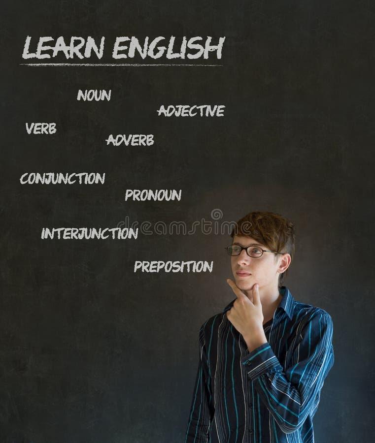Выучите учителя английского с предпосылкой мелка стоковые фото