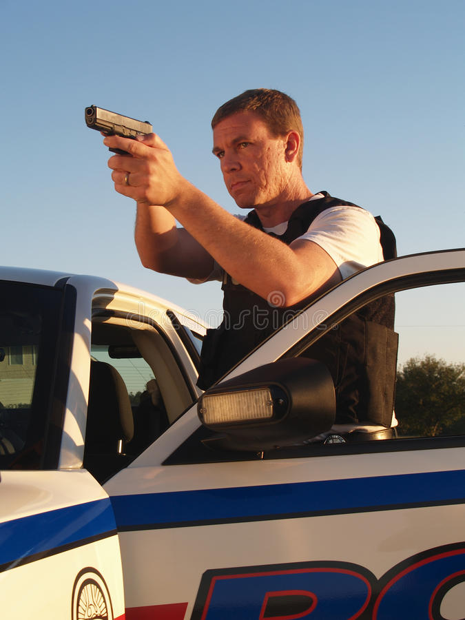 вычерченное оружие полицейския стоковые фото