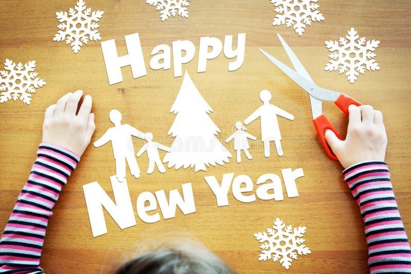 Вычуры маленькой девочки о празднике Нового Года стоковое фото