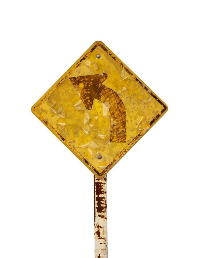 Выдержанное ржавое поворота движения знака 3 изолята moldy старое стоковая фотография