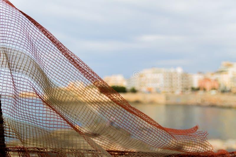 В близком взгляде фокуса пластиковой загородки экрана конструкции из предпосылки фокуса стоковое изображение