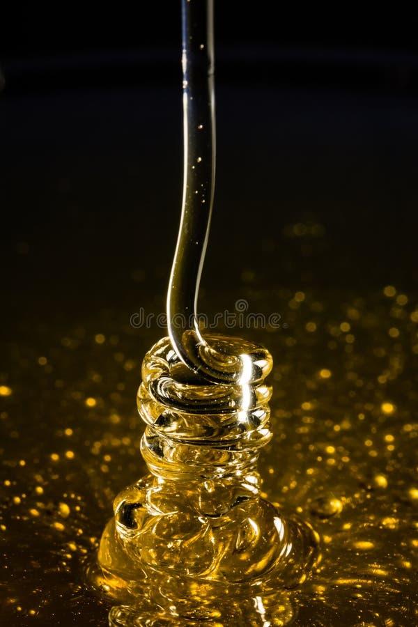 Влияние меда свертываясь спиралью стоковое изображение rf