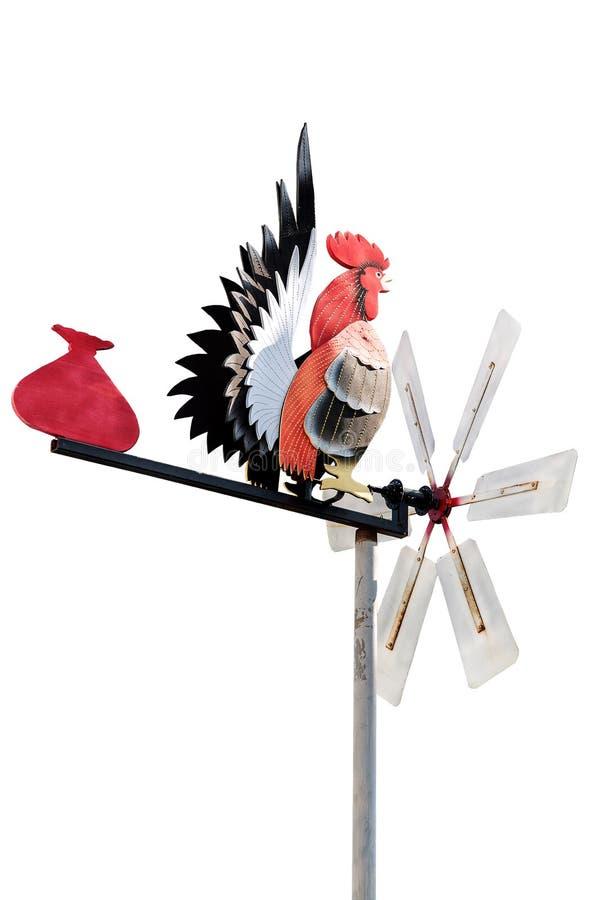 в форме Куриц лопасть погоды над верхней частью заострённый-настелинный крышу дом ag стоковые фотографии rf