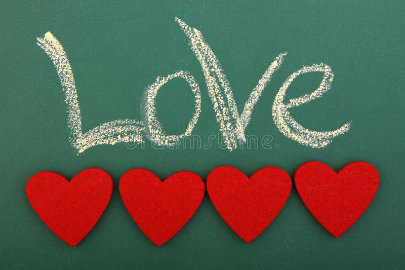 Влюбленность классн классного с 4 сердцами стоковые фото