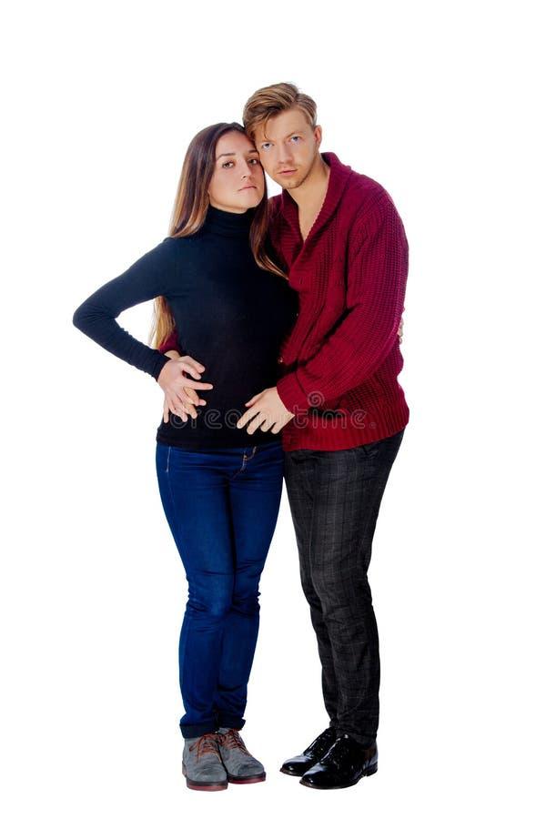Гай белокурое и девушка брюнет в брюках стоковая фотография rf