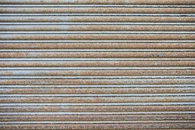 Гараж пакостный и текстура металла окиси стоковое фото