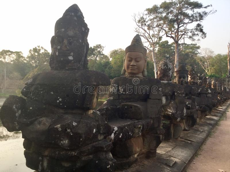 Гигантская каменная сторона Старый Индусское Devas Камбоджа стоковое фото