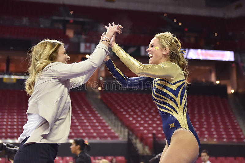 2015 гимнастика дам NCAA - WVU стоковые фотографии rf