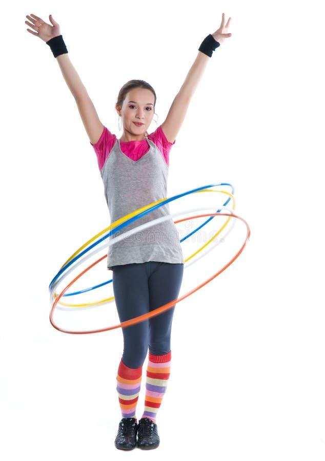гимнастика девушки звенит завальцовка стоковое фото