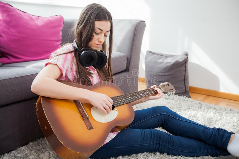 Attractive Young Woman Playing Acoustic Guitar While Resting Thothub 1