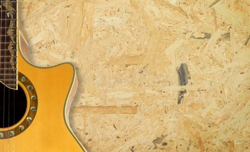 Гитара на космосе экземпляра предпосылки текстуры переклейки стоковые изображения