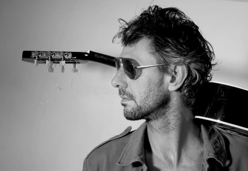 Гитара человека стоковая фотография rf