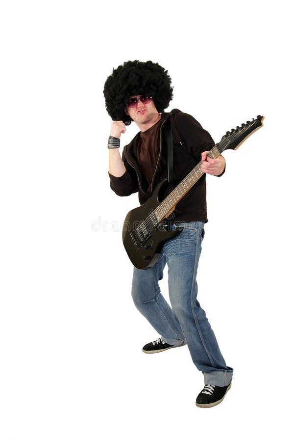 гитарист кулачка его поднимая детеныши стоковая фотография rf