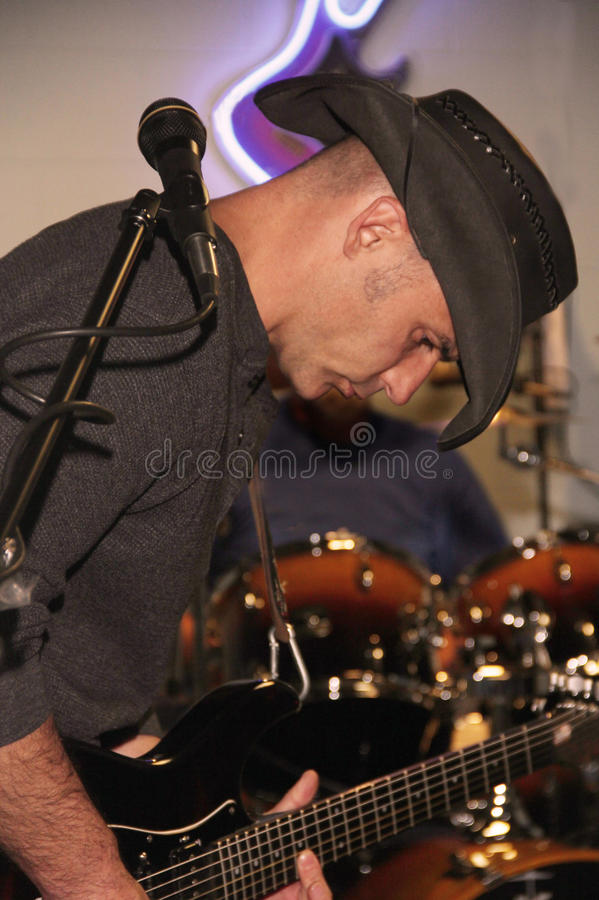 Гитарист руководства стоковое фото