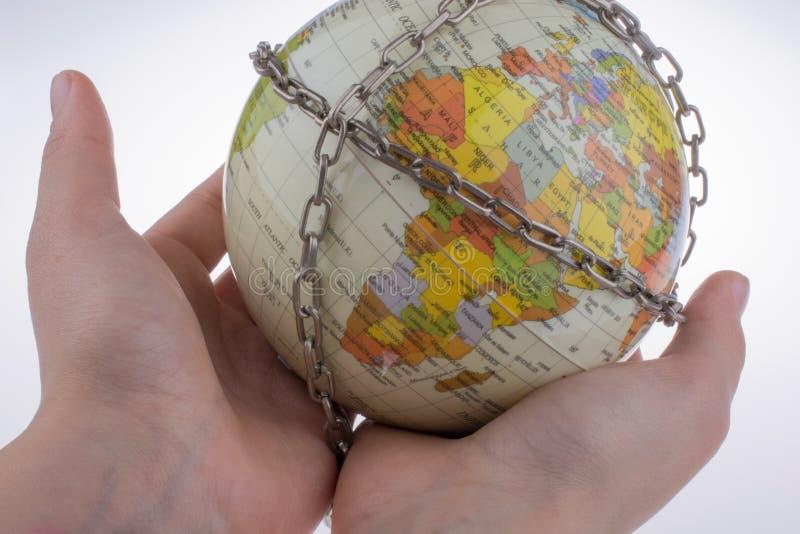 глобус в цепях стоковая фотография rf