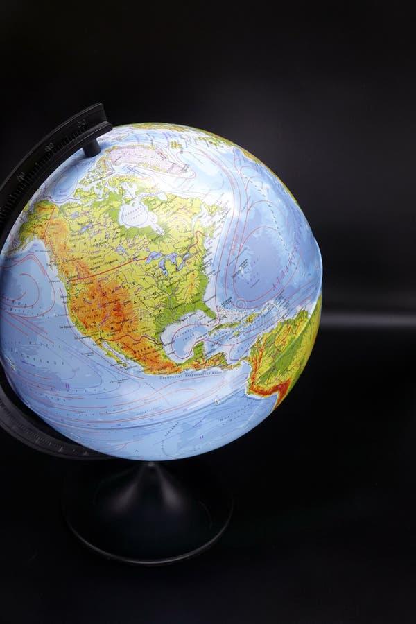 Глобус на темной предпосылке  стоковые изображения