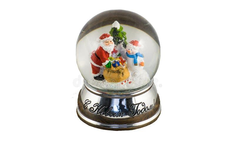 Глобус снега с счастливыми снеговиком и Санта Клаусом стоковые фото