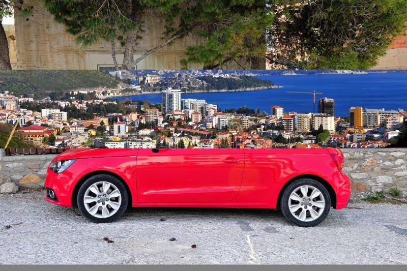 Глубоко - красное Audi A1 в улице стоковая фотография rf