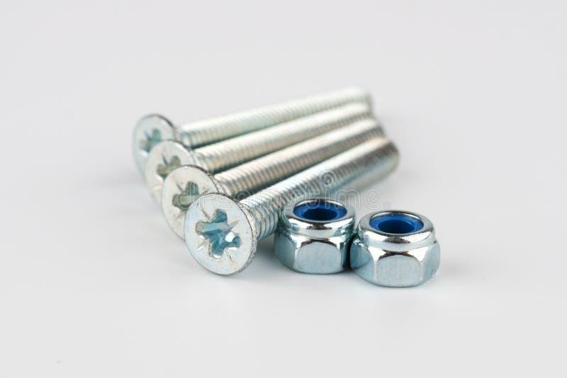 Глянцеватые гайки металла - и - болты стоковая фотография rf