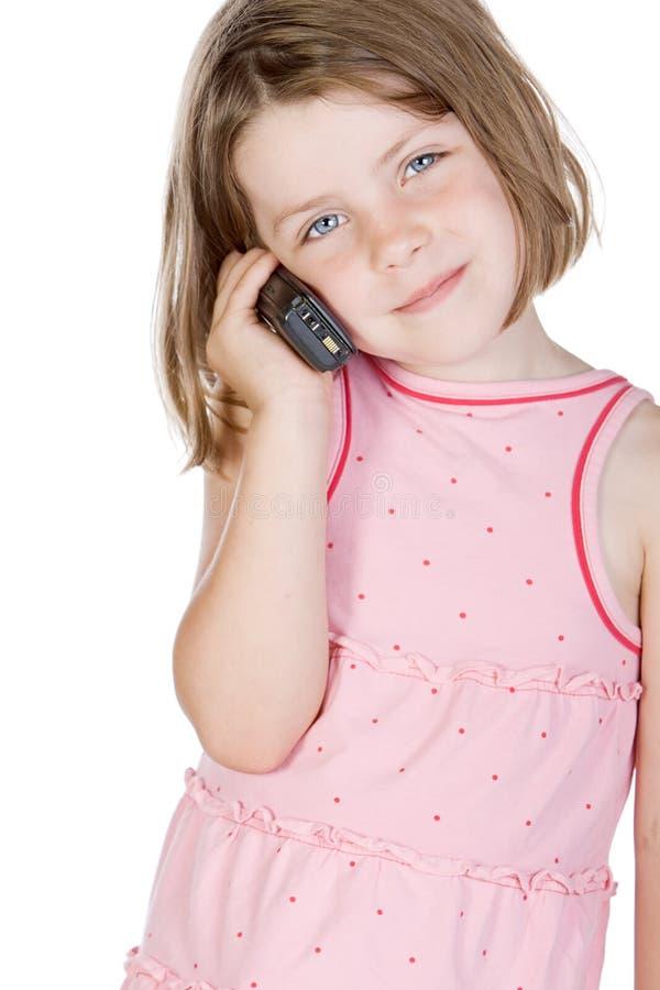 говорить телефона белокурого ребенка милый стоковые фото