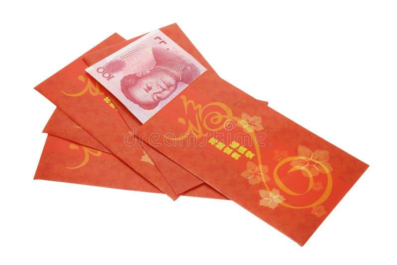 год renminbi китайских пакетов валюты новых красный стоковое изображение rf