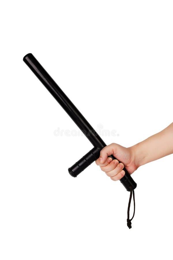 Голая рука с черным резиновым жезлом полиции изолированным на белой предпосылке стоковое фото rf