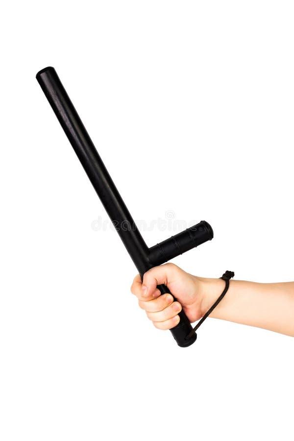 Голая рука с черным резиновым жезлом полиции изолированным на белой предпосылке стоковое изображение rf
