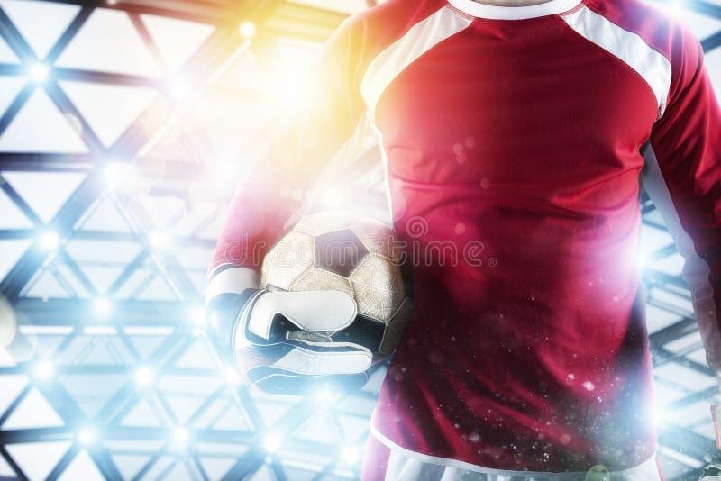 Голкипер держит шарик в стадионе во время футбольного матча стоковое фото