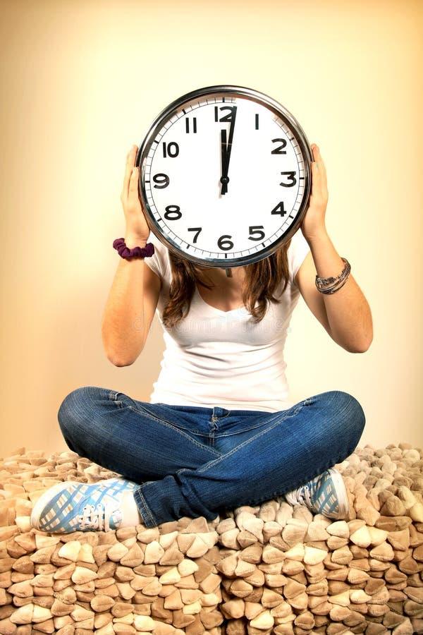 головка девушки часов стоковое фото rf